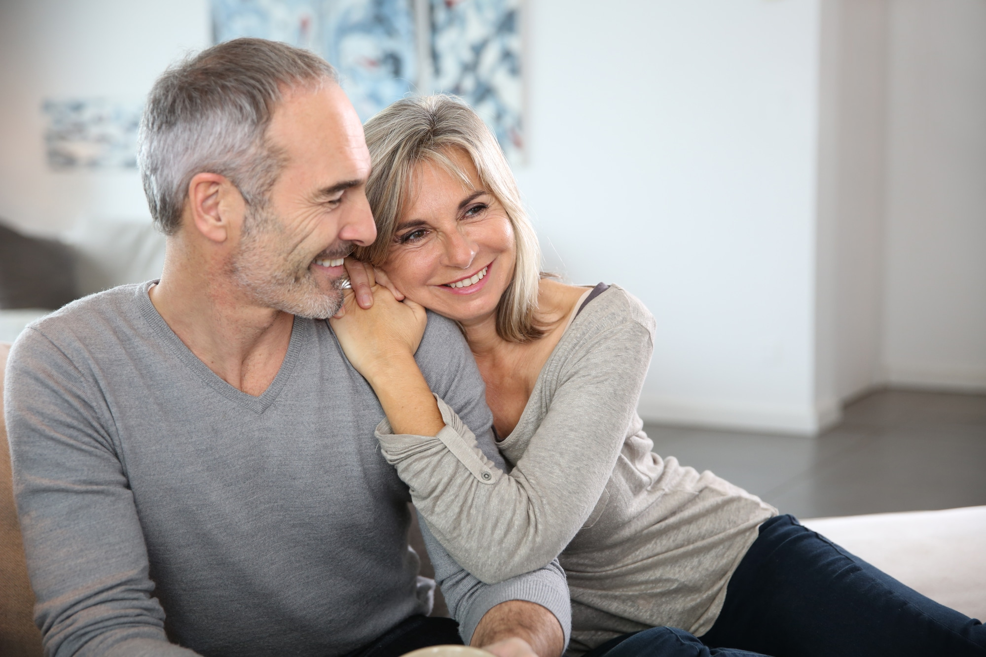 Romantic senior couple relaxing in couch